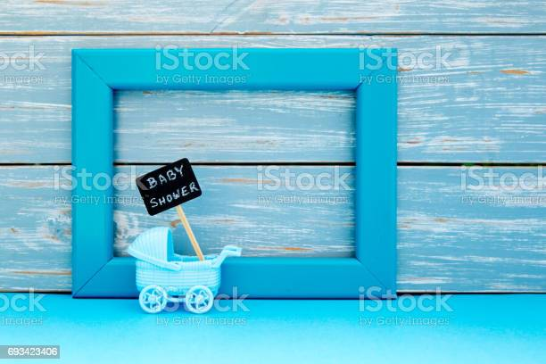 Baby shower toy pram with backboard sign with blue frame and wooden picture id693423406?b=1&k=6&m=693423406&s=612x612&h=q1yjhyt51pn8acixejiw955hwcj3a4p7strudp48uqe=