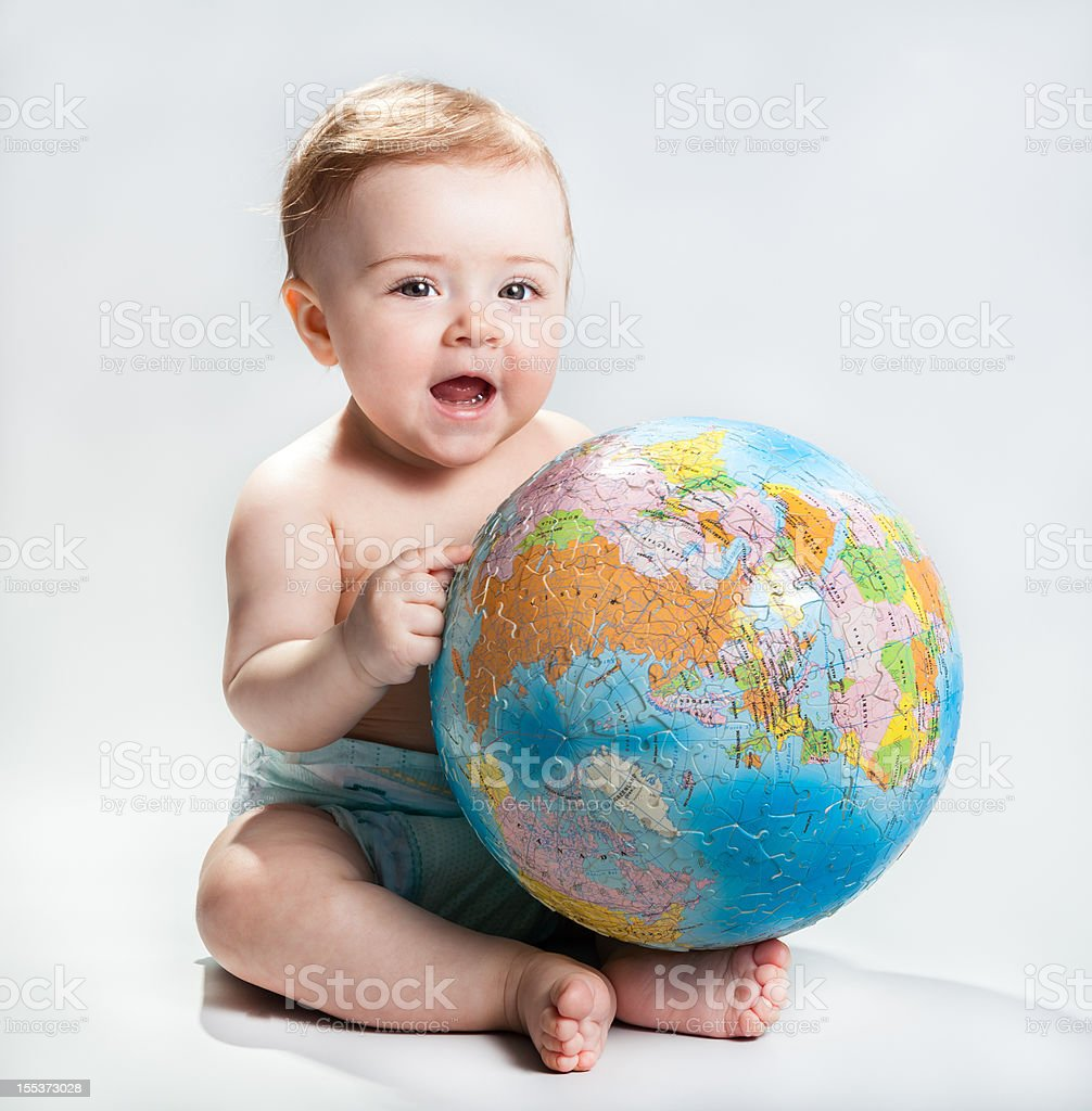 Baby showing the planet Earth royalty-free stock photo