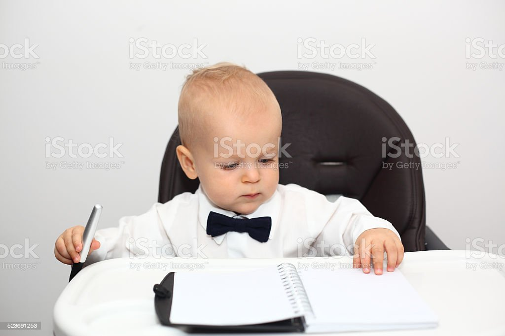 Baby signing documents stock photo