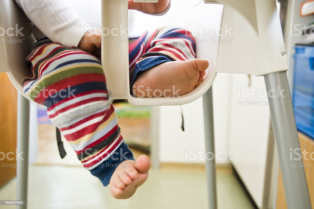 Baby Sitting in High Chair stock photo