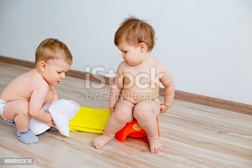 istock Baby sitting on a potty 899955376