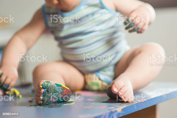 Baby sitting on desk and painted picture id509924412?b=1&k=6&m=509924412&s=612x612&h=52cckokajntwu vchzsb04kb7zdonunymp6i dype2o=