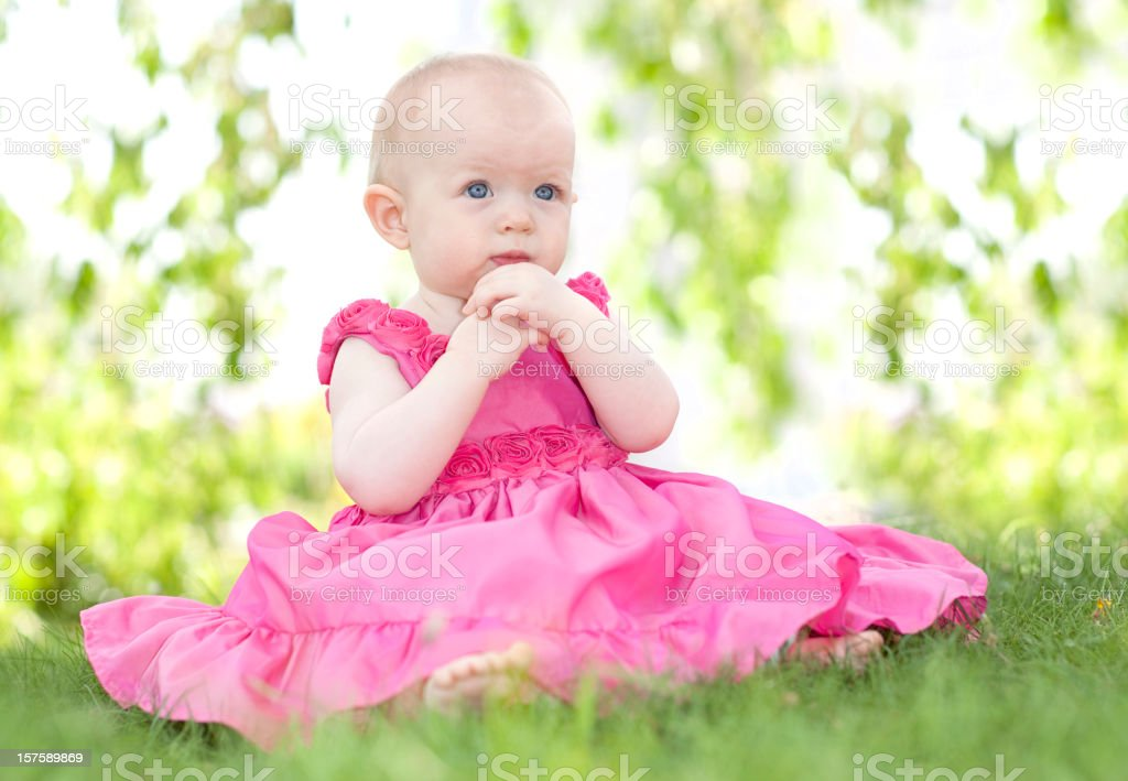 Baby sitting outdoors. royalty-free stock photo