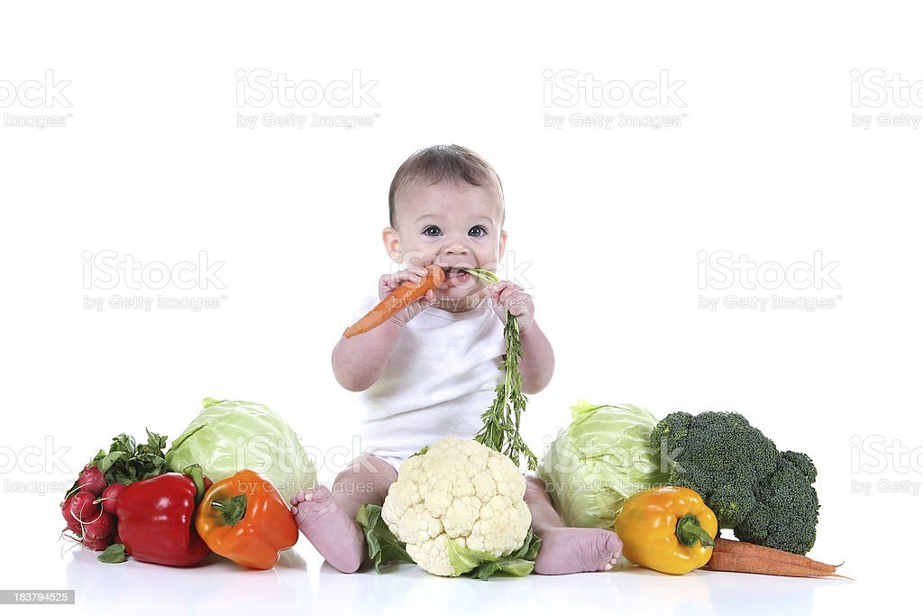 Baby Sitting with Organic Vegetables royalty-free stock photo