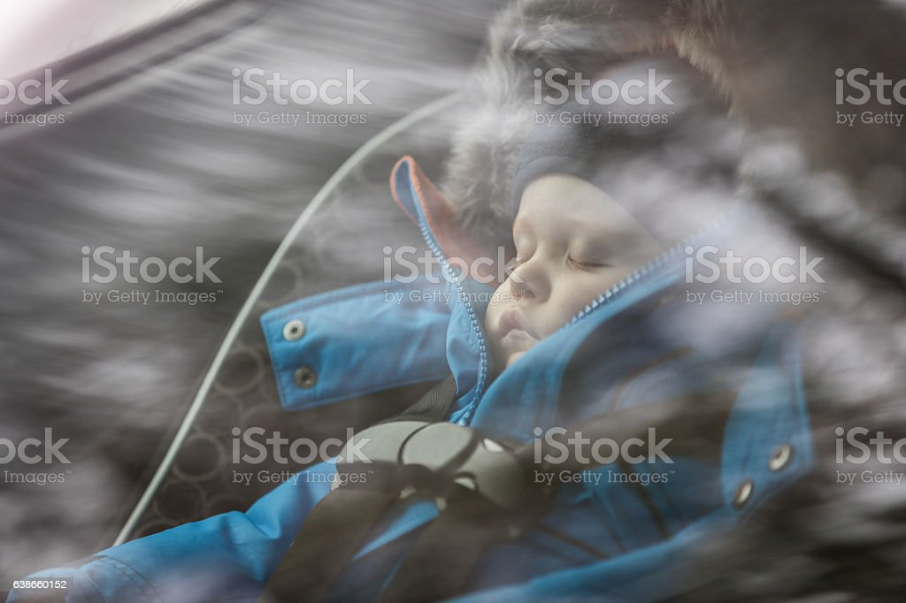 Baby Sleeping in Car Seat, Winter Season stock photo