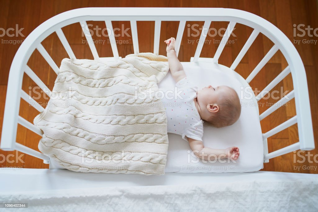 Baby Sleeping In Cosleeper Crib Attached To Parents Bed Stock Photo    Download Image Now