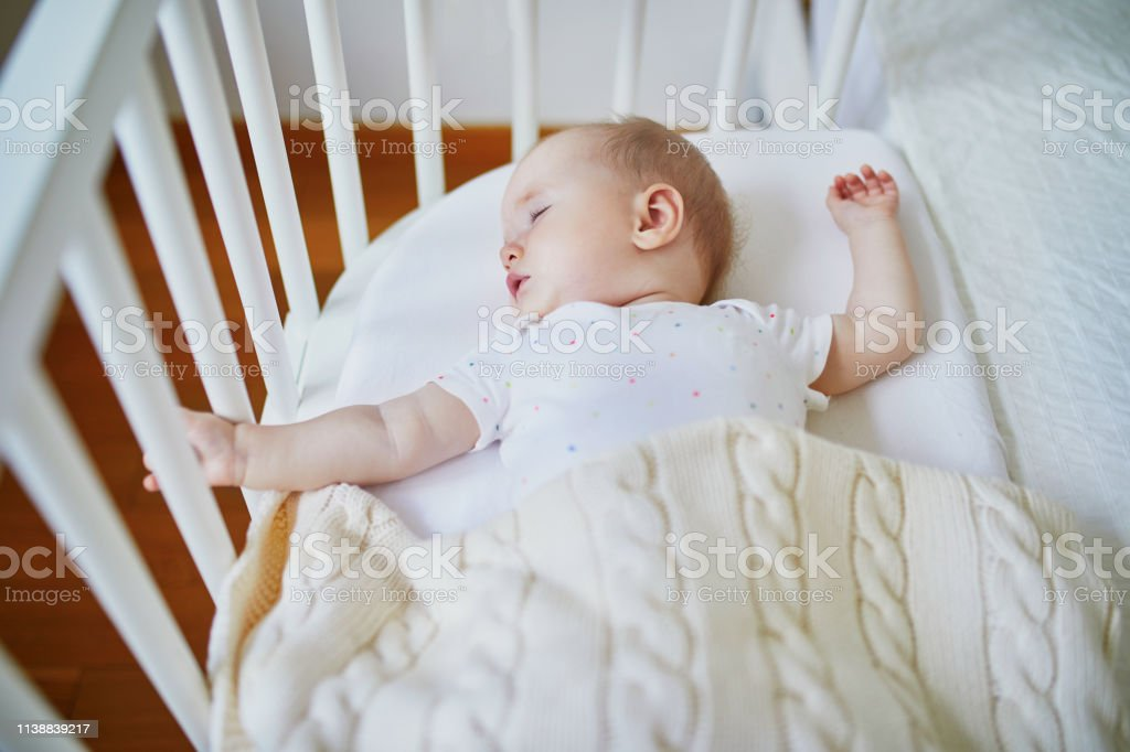 Baby Sleeping In Cosleeper Crib Attached To Parents Bed Stock Photo Download Image Now Istock