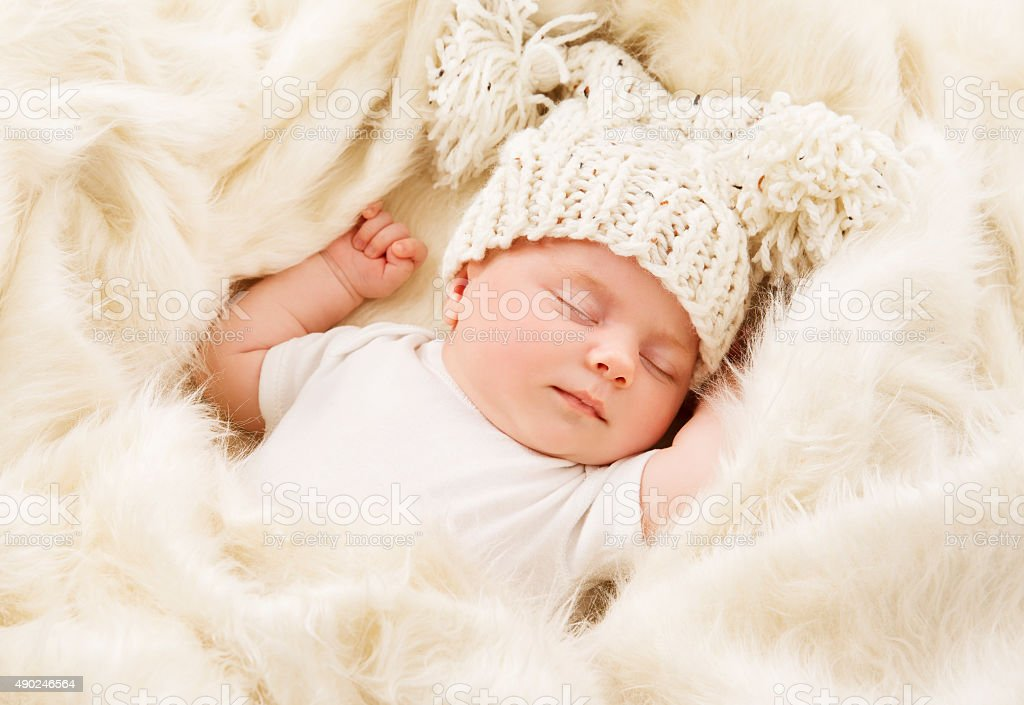 Baby Sleeping, Newborn Kid Sleep in Hat, New Born Girl stock photo