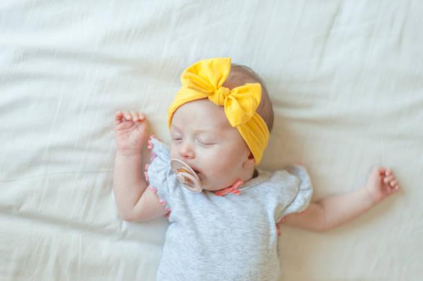 Baby sleeping on bed stock photo