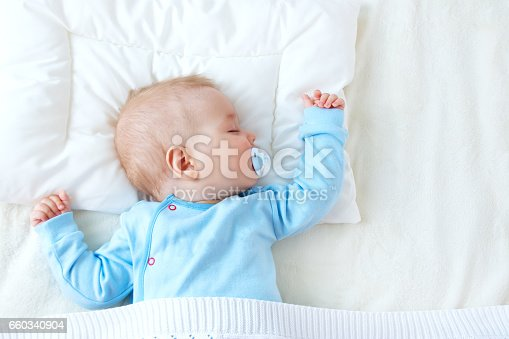 istock baby sleeping on blue blanket 660340904