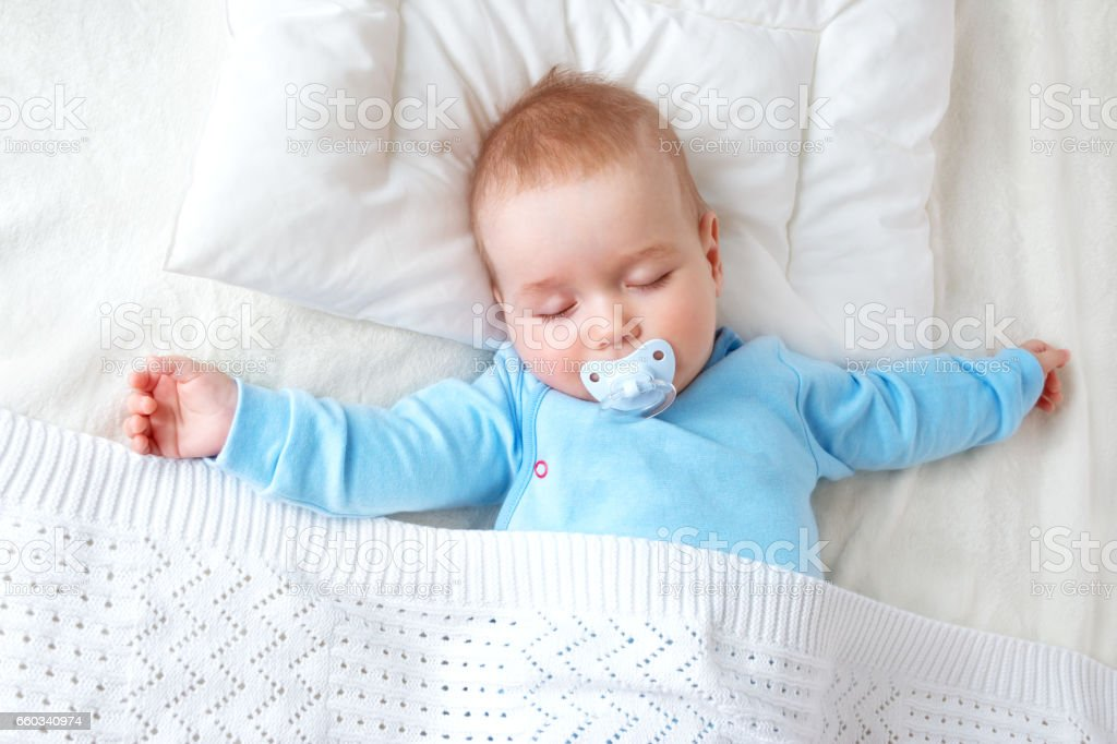 Baby Sleeping On Blue Blanket Stock Photo Download Image