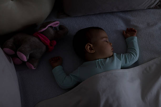 Baby Sleeping on the bed stock photo