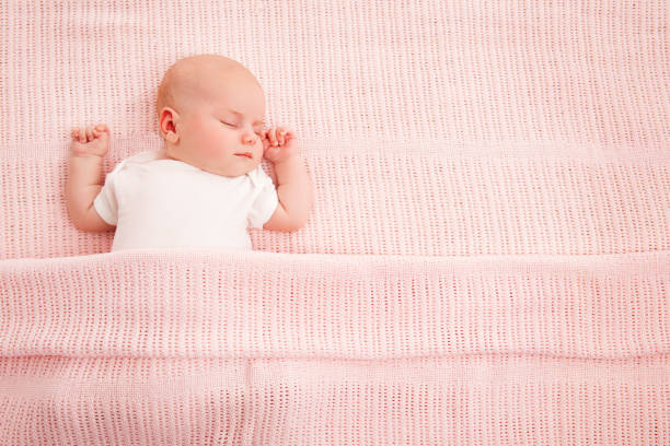 baby sleeping - newborn baby girl stock photos and pictures