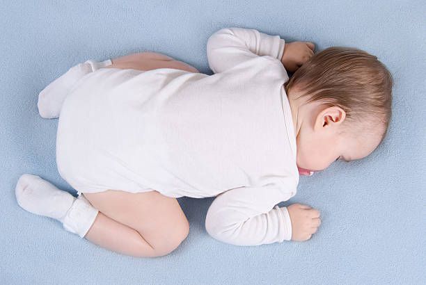 Baby sleeps on soft blue blanket. Top view stock photo