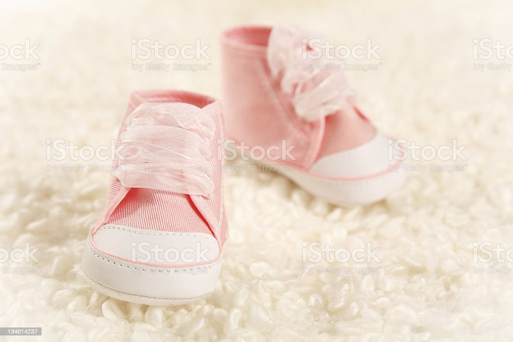baby slippers in soft plaid stock photo