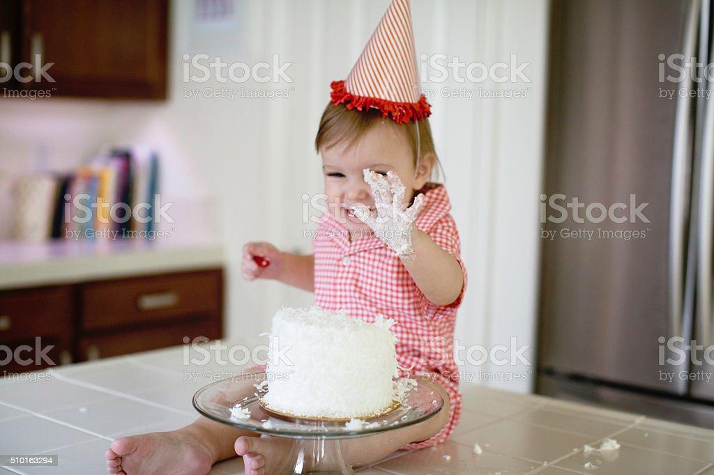 Baby Smashing a First Birthday Cake stock photo