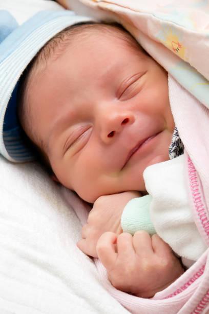 Baby smile in dreams stock photo