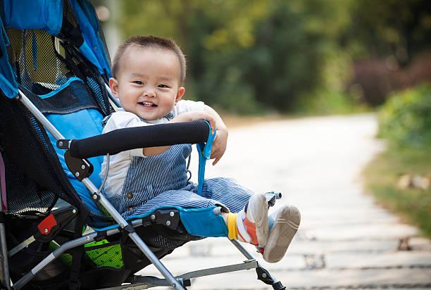 Baby smiling sitting stroller stock photo