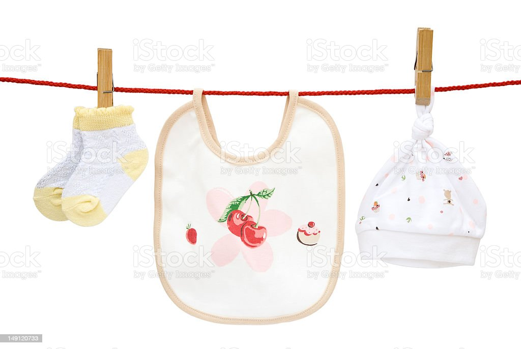 baby socks and bib plus cap hanging with clipping path stock photo