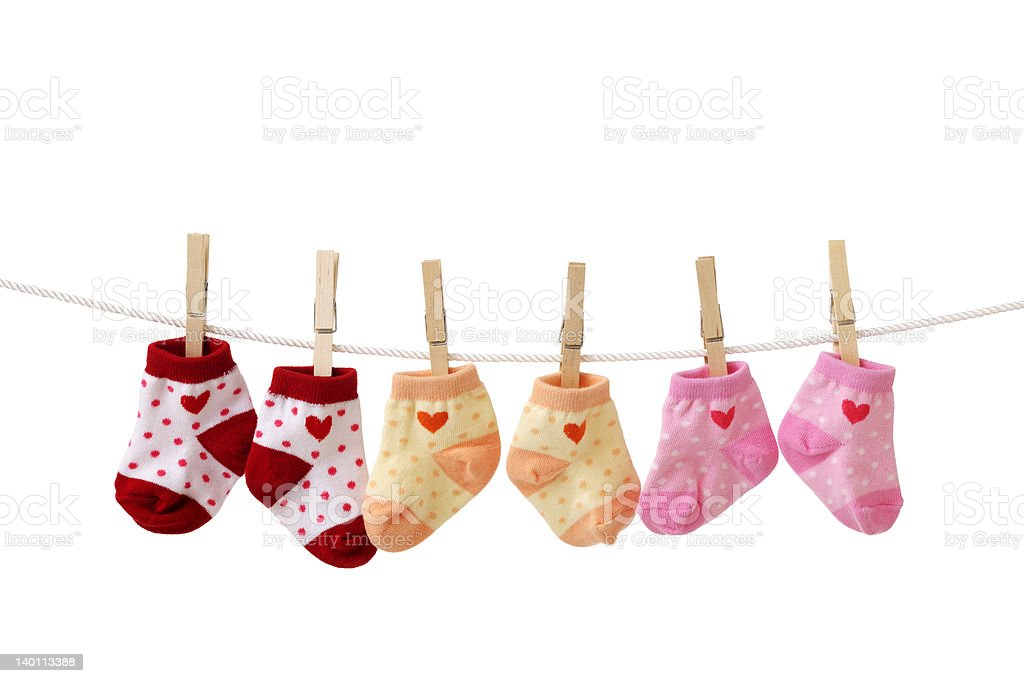 Baby socks hanging on a clothesline stock photo