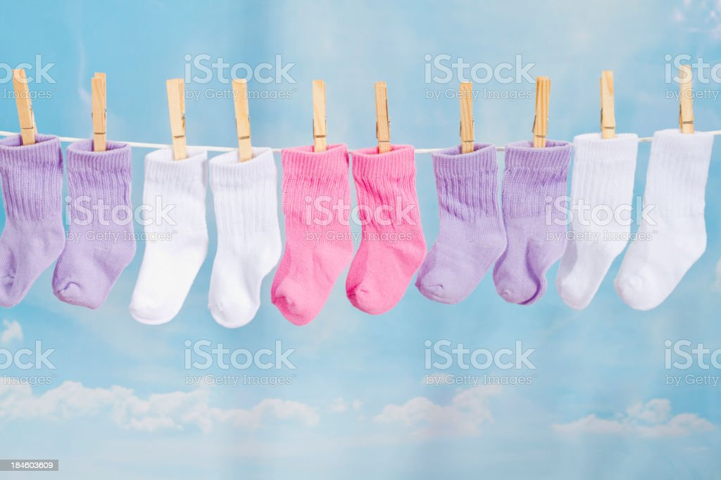 Baby Socks Hanging On A Clothesline Baby Socks Hanging On A Clothesline Baby - Human Age Stock Photo