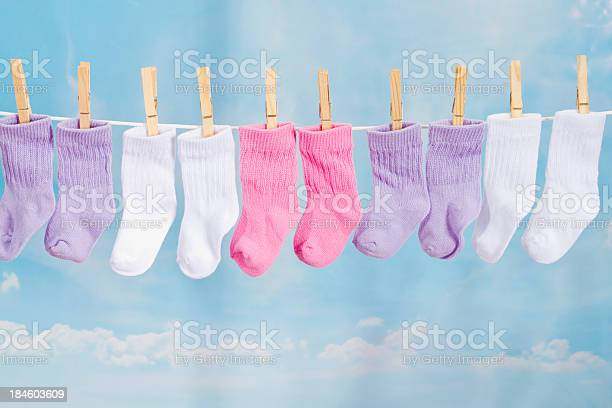 Baby Socks Hanging On A Clothesline Stock Photo - Download Image Now