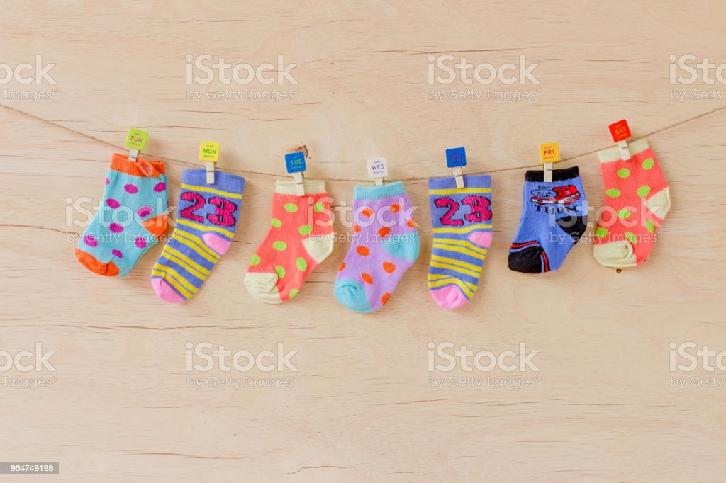 Baby socks on wooden background royalty-free stock photo