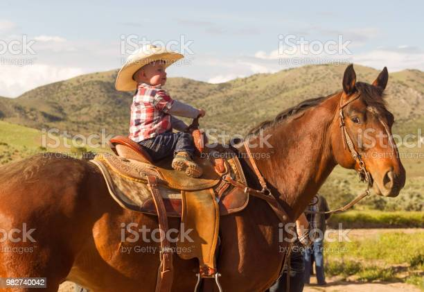 Baby son riding horse at santaquin salt lake city slc utah usa picture id982740042?b=1&k=6&m=982740042&s=612x612&h=ytkwlkwggryb szzcw7tyohnlv9zxmqennt 8qwmtia=