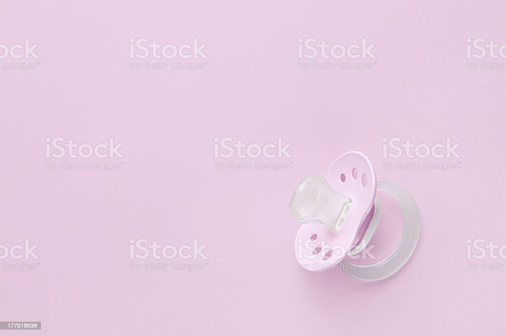 Baby soother in pink stock photo