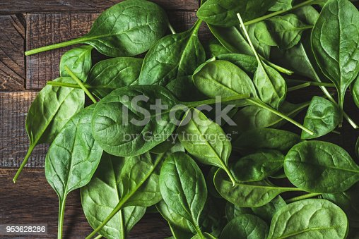 Baby spinach leaf on wood as a background. Horizontal composition. Detox, healthy lifestyle, healthy eating, vegan diet concept