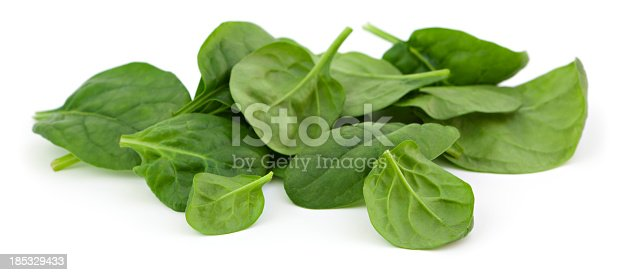 Baby spinach leaves on white background.