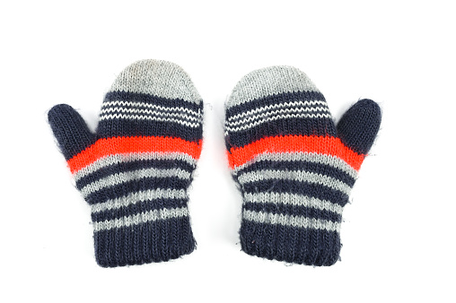 Baby striped mittens, on an isolated white background . High quality photo