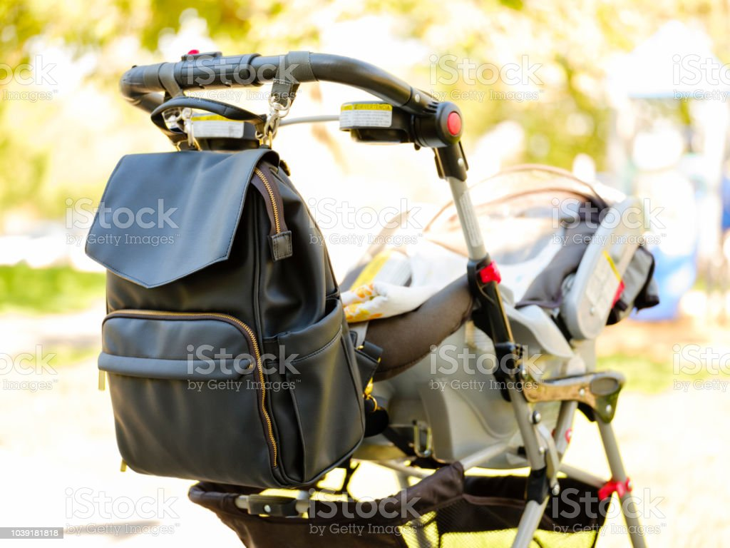 Baby Stroller and Diaper Bag stock photo