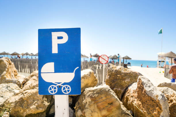 Baby stroller parking lot area by the beach stock photo