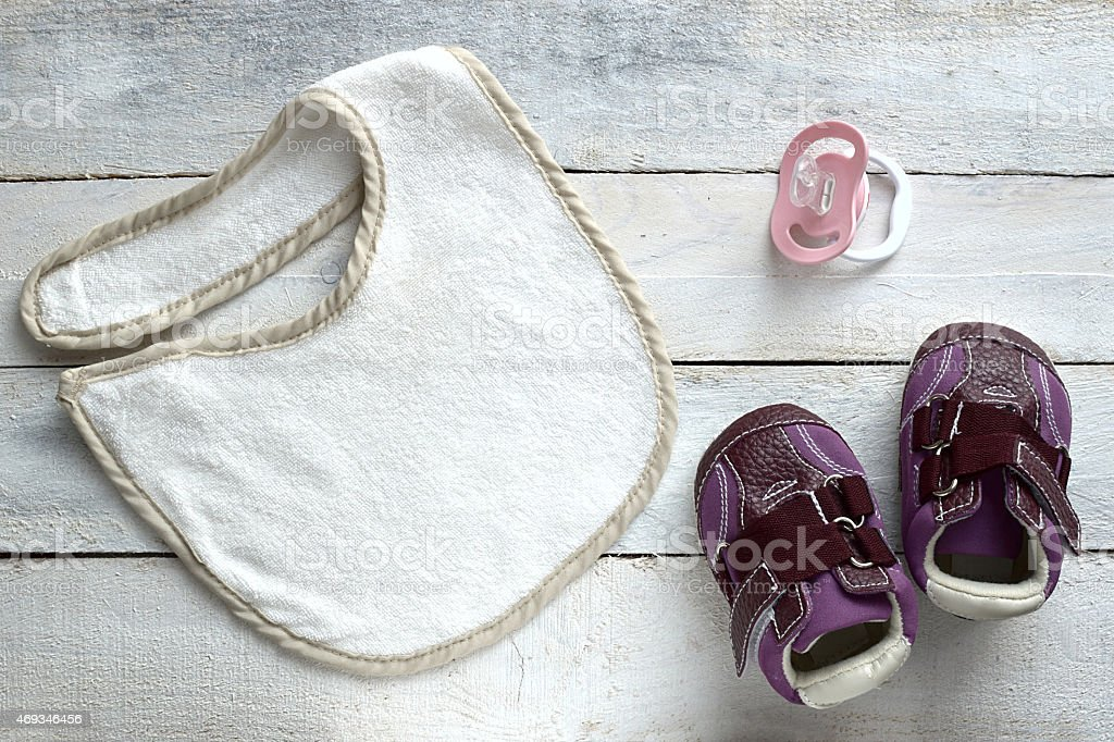 Baby stuff on white wood stock photo
