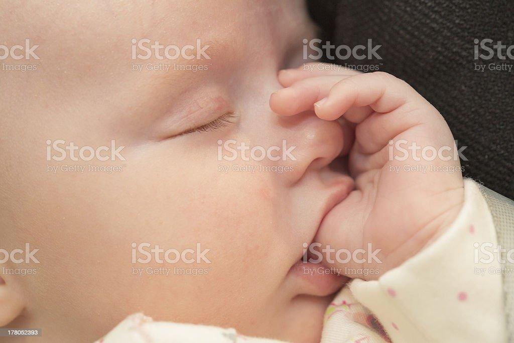 Baby sucking thumb stock photo