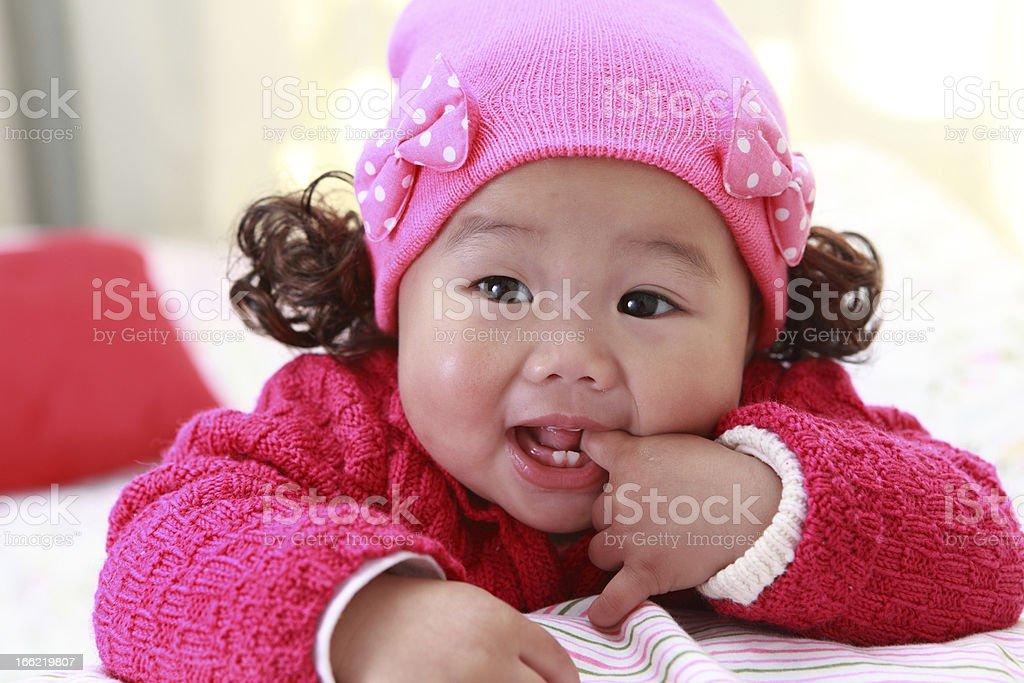 Baby Sucks on Her Fingers royalty-free stock photo