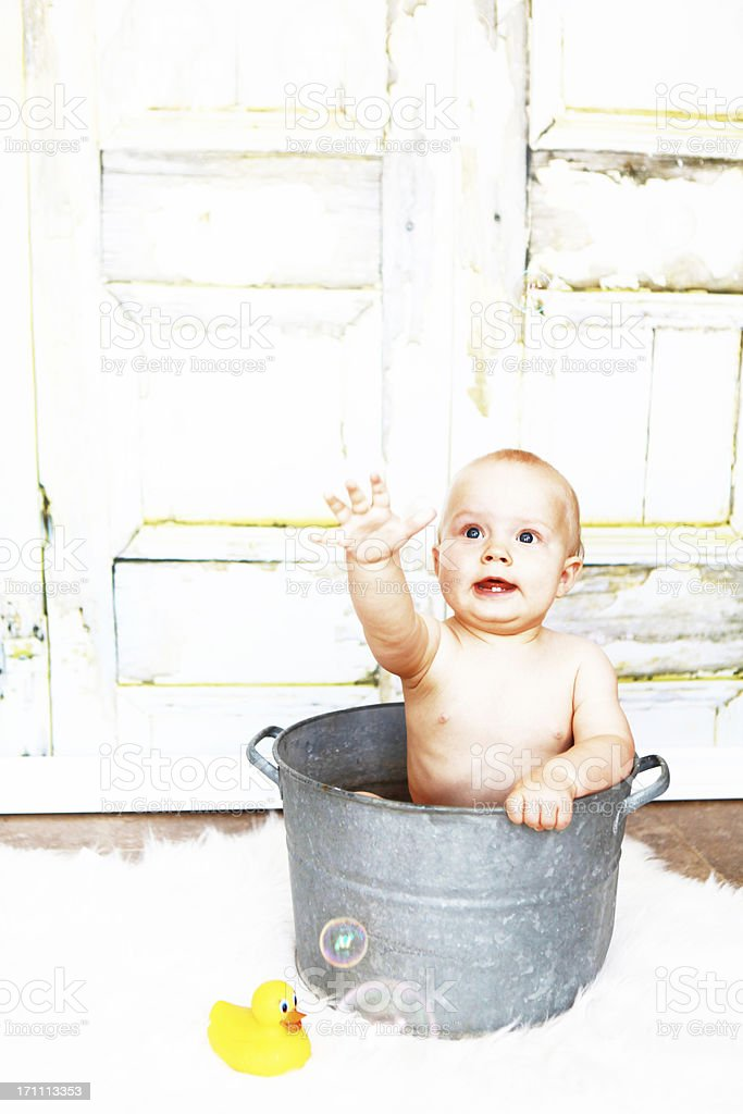 Baby Taking Bath in Antique Pot royalty-free stock photo