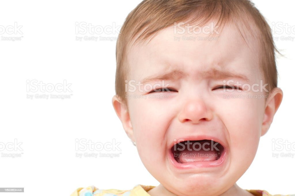 A baby that is crying because she is upset about something royalty-free stock photo