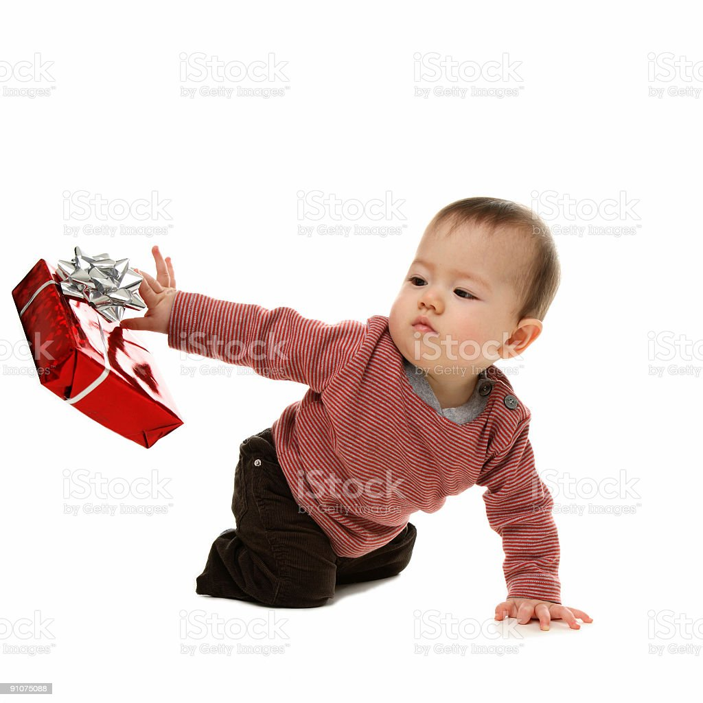 Baby throws present away. royalty-free stock photo