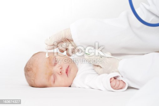 istock Baby to the dermatologist 163674327