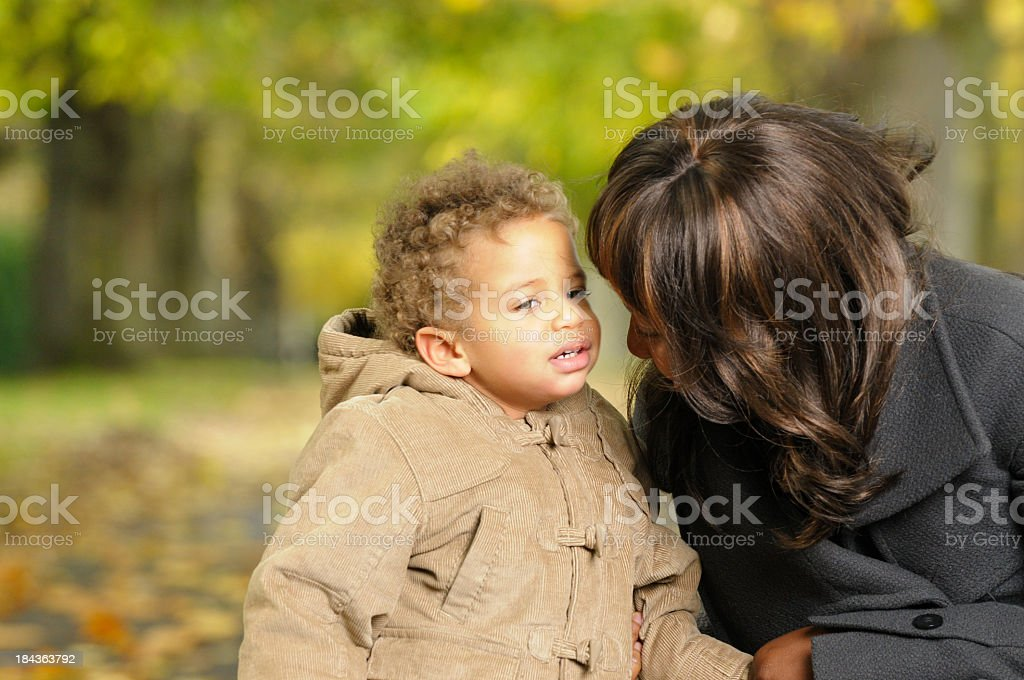 Baby/ Toddler Speaking To His Mother/ Carer In The Park royalty-free stock photo