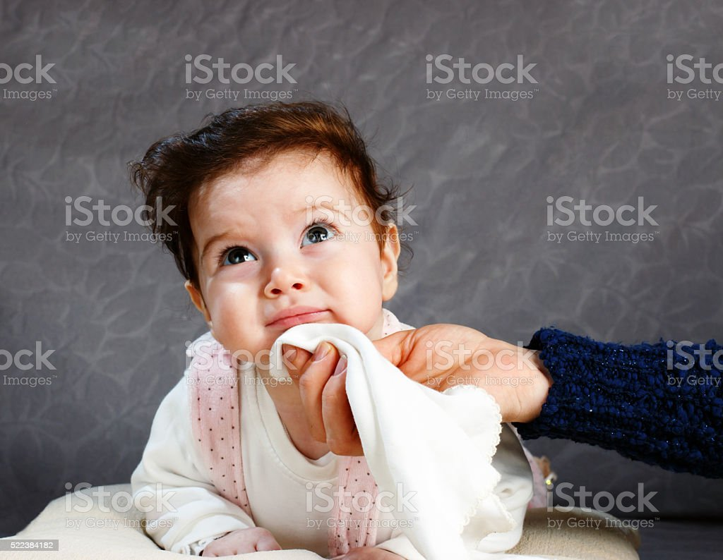 Baby tooth itch and mouth water stock photo