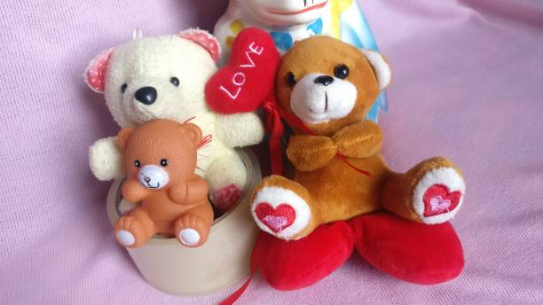 Baby toys close up teddy bear with love heart Teddy bear toys objects creation teddy bear stock pictures, royalty-free photos & images