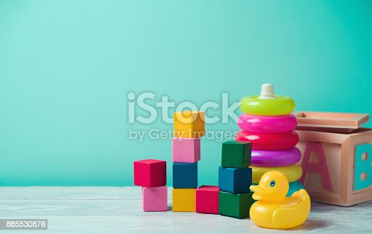 istock Baby toys on wooden table 885530876