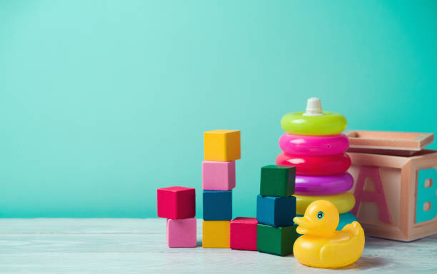 Baby toys on wooden table stock photo