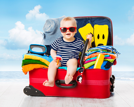 Baby Travel Suitcase Kid Luggage Packed For Vacation Full Clothes Stock Photo - Download Image Now