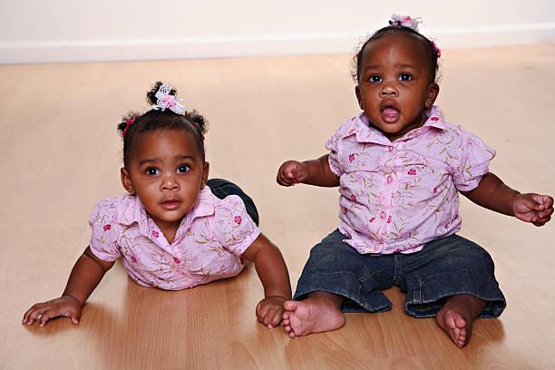 Baby Twin Girls stock photo