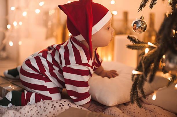 Baby under Christmas tree stock photo