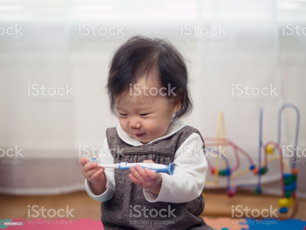 baby using tooth brush first time stock photo